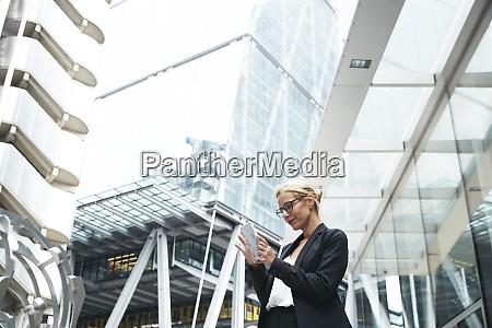 beautiful female professional using smart phone