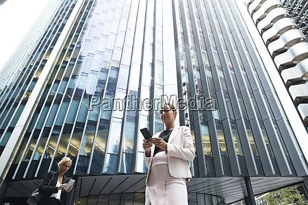 female entrepreneurs using smart phones against