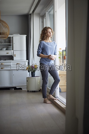mid adult woman holding coffee cup