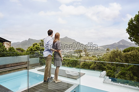 heterosexual couple standing while looking at
