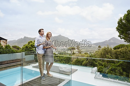 couple holding wine glass while standing