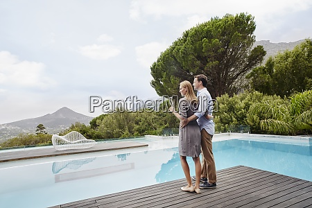 heterosexual couple looking at view with