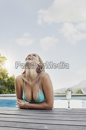 young woman laughing on sunny day