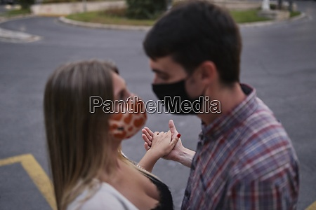 couple wearing protective face mask with