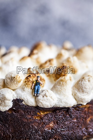 miniature of manual worker sitting at