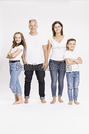 smiling family standing against white background
