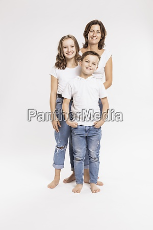 mother with children standing against white