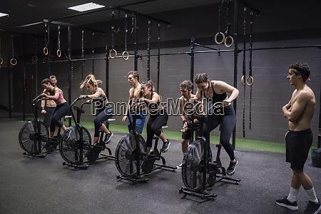 athletes exercising on fitness bike at