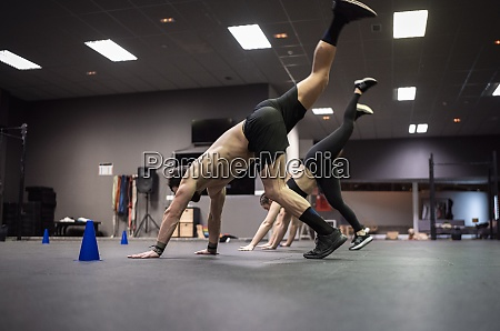 male athletes exercising in gym