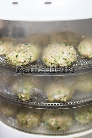 chicken cutlets with greens are steamed
