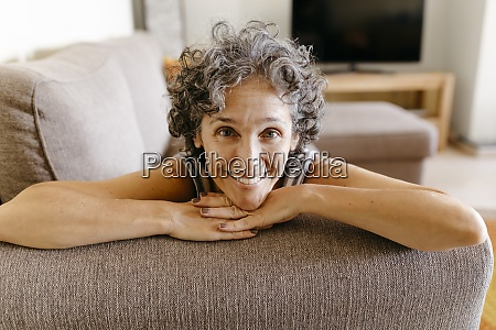 smiling woman resting while leaning on
