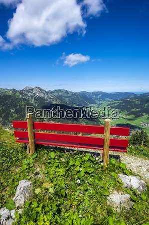 austria tyrol red painted bench along
