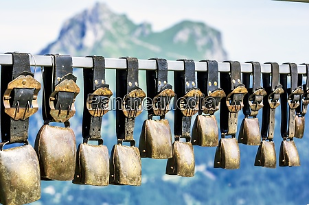 row of cow bells hanging outdoors