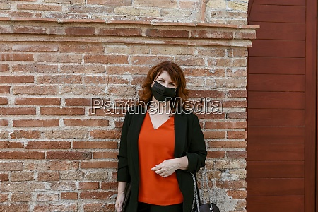 woman with protective face mask standing
