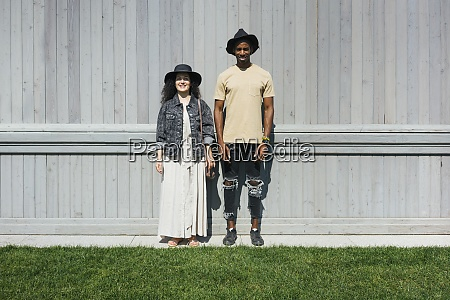 man and woman wearing hat standing