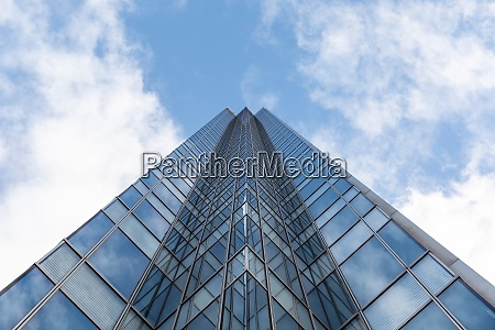 tall modern office glass skyscraper against