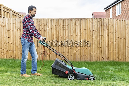 man mowing with lawn mover at