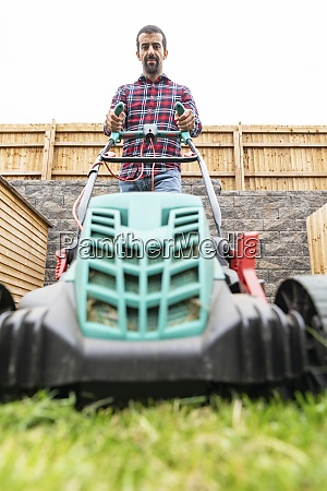 man working with lawn mower at