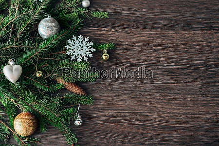 christmas tree branches and snowflakes on