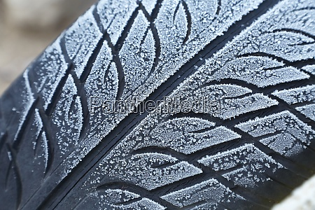 abandoned car tyre in winter