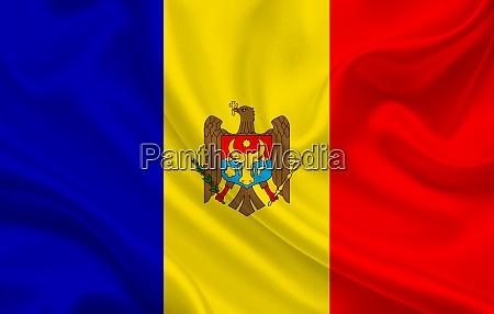 moldova country flag on wavy silk