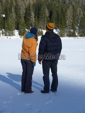 couple talking a walk in winter