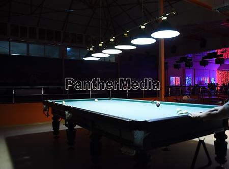 russian billiards playing billiards in a