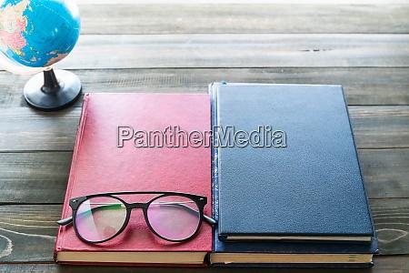 reading glasses put on hardcover books