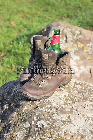 abandoned pair of walking boots on