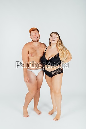 happy young couple wearing underwear full
