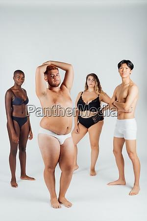 four young men and women wearing