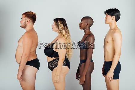 young people wearing underwear standing in