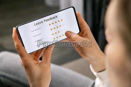 customer review woman using phone