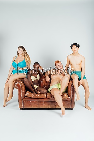 young people on sofa wearing underwear