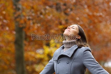middle age female breathing fresh air