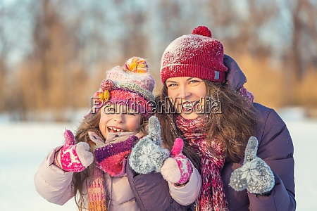 positive mother and daughter playing in