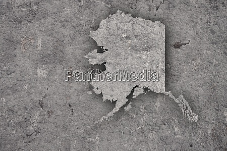 map of alaska on weathered concrete