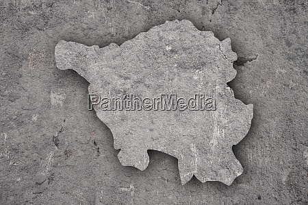 map of saarland on weathered concrete