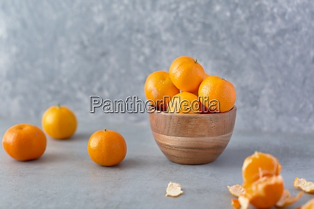 fresh whole clementine fruits on neutral