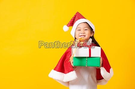 kid dressed in red santa claus
