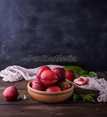 red ripe peaches nectarine in a