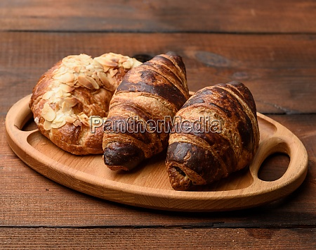 two baked croissants lie on a