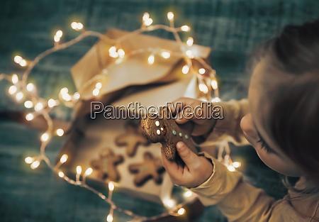 kid with christmas cookies