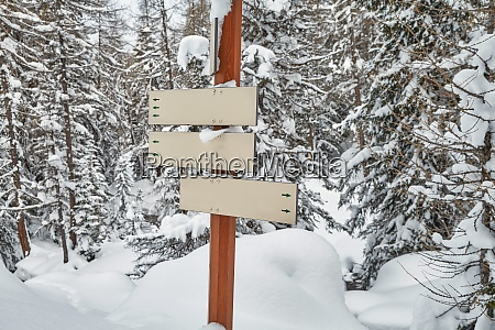 winter snowy mountain hiking signs