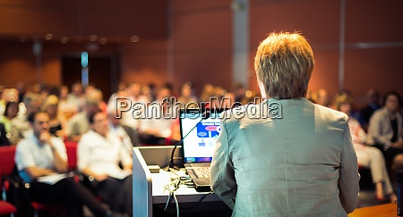 business woman lecturing at conference