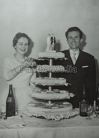 newlyweds with wedding cake 60s 6