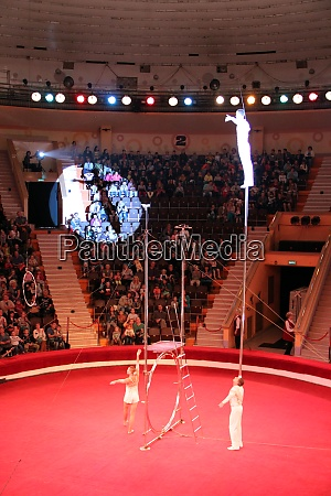 gymnasts perform unimaginable tricks under dome