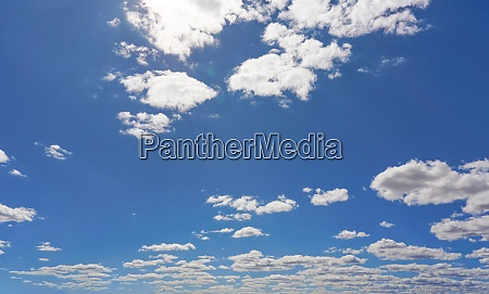 bright sky background with few small
