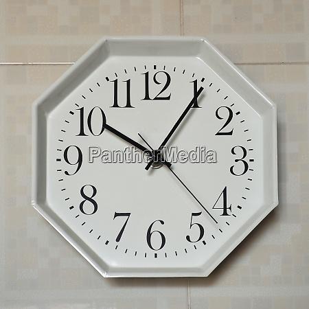 wall clock at five past ten