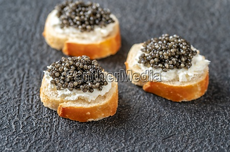 canape with black caviar